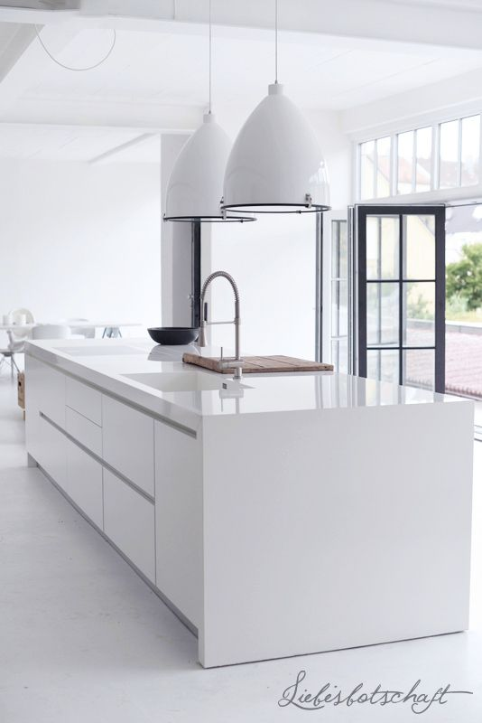 white modern kitchen ideas. this modern white kitchen is complete with a glossed finish ideas