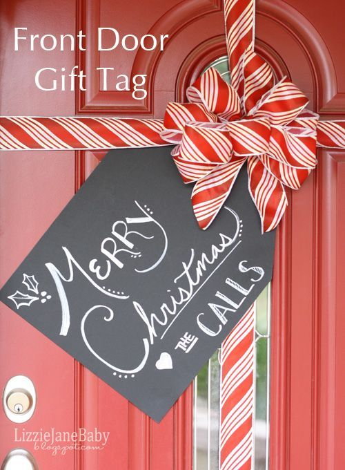 Gift wrapped front door with tag for christmas