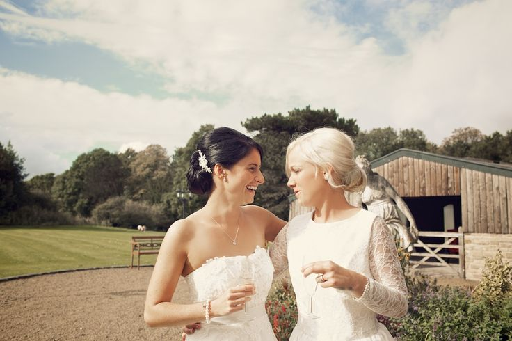 Image by Weddings Vintage Photography - A bespoke lace bridal gown and a Monsoon wedding dress for a rustic wedding at Hyde Bank Farm with Gypsophila bouquets by Weddings Vintage Photography.