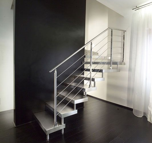 MARRETTI spiral staircase spiral stairs and banisters, staircase design production and selling,Steel Cantilever staircase 13,Open cantilever staircase,without risers, with stainless steel-lined steps with invisible welding and banister in horizontal stainless steel rods.