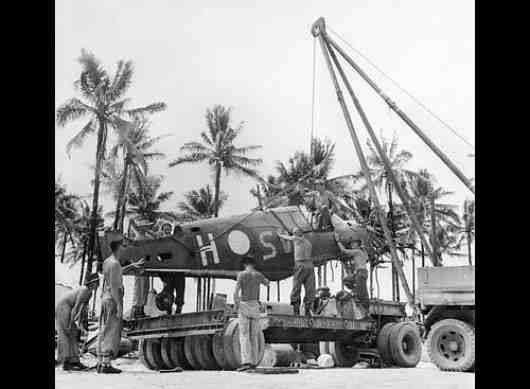 A damaged and dismantled Kittyhawk of 76 Squadron RAAF is loaded onto a truck on Los Negros Island in the Admiralties in early 1944