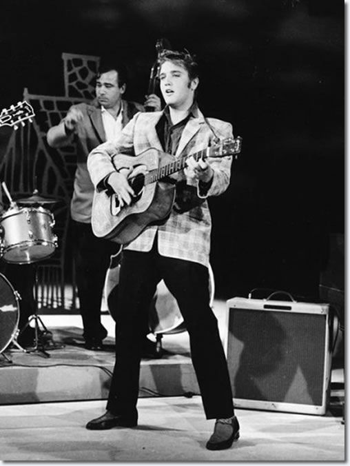 Elvis Presley | First appearance on The Ed Sullivan Show on September 9, 1956 ~ Viewers got to see the full Elvis - legs, hips, and all - during the second segment, when he performed the up-tempo Little Richard song 'Ready Teddy' and two verses of 'Hound Dog.' Young rock fans today would doubtless have a hard time understanding what all the scandal was about, as his frenetic swivels and shuffles look chaste compared to the gyrations common on MTV. But Elvis on that night (and his rock star…