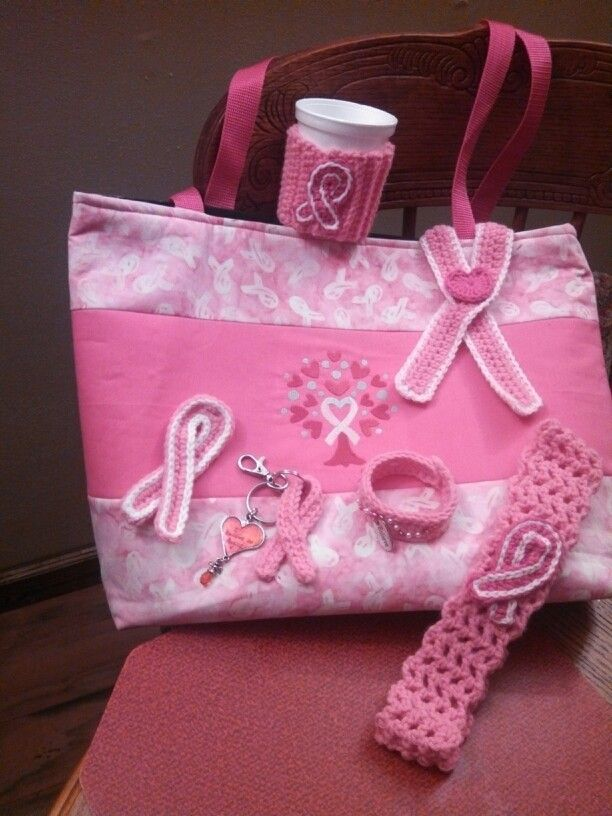 Crocheted items for breast cancer awareness:  coffee cup cozy, emblem with heart, headband, key ring, bracelet, emblem pin (tote bag made by a friend)