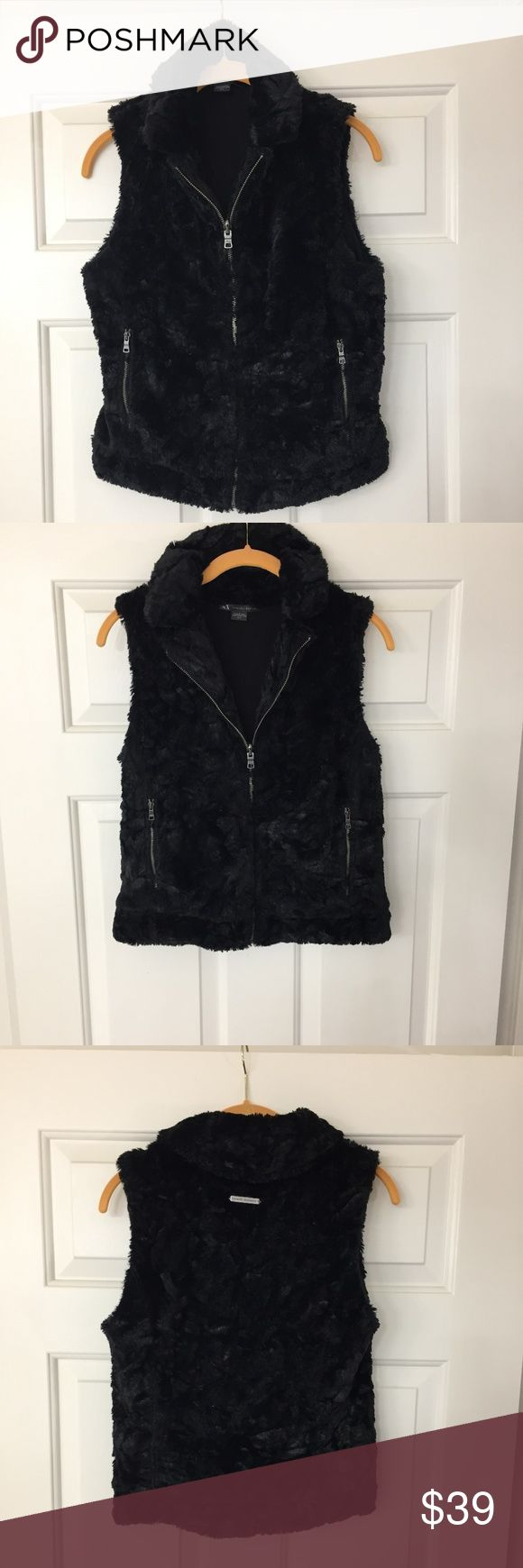 PRICE REDUCED-Armani Exchange Reversible BlackVest This Armani Exchange Reversible Black Faux Fur Vest is in Excellent Used Condition (EUC). Size Medium. It has 2 side zip pockets on the fur side and 2 side pockets on the reversible side too. The vest is 20.5 inches long back and the front is the same length. It's gorgeous waist line, flattering, and warm vest. Armani Exchange Jackets & Coats Vests