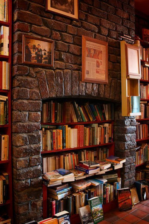 Red shelves and fireplace