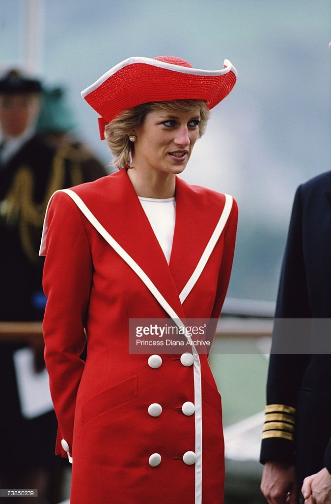 Princess Diana wearing a red Catherine Walker suit and Philip Somerville hat while attending a...