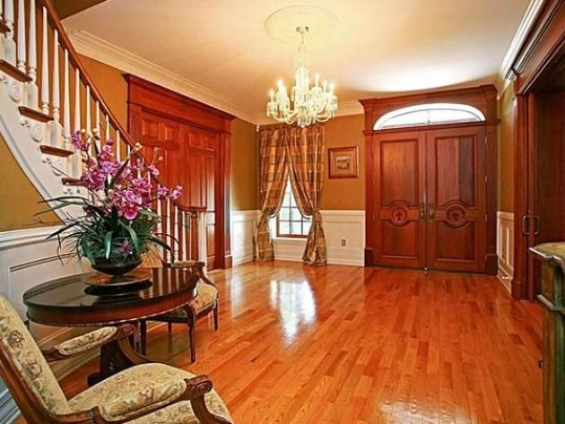 Joey Fatones Orlando Home: Foyer wood floor, wood doors. wood molding, triple floor molding, chair rail high wainscoating, Great Curtains