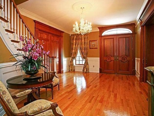 Joey Fatones Orlando Home: Foyer wood floor, wood doors. wood molding, triple floor molding, chair rail high wainscoating, Great Curtains