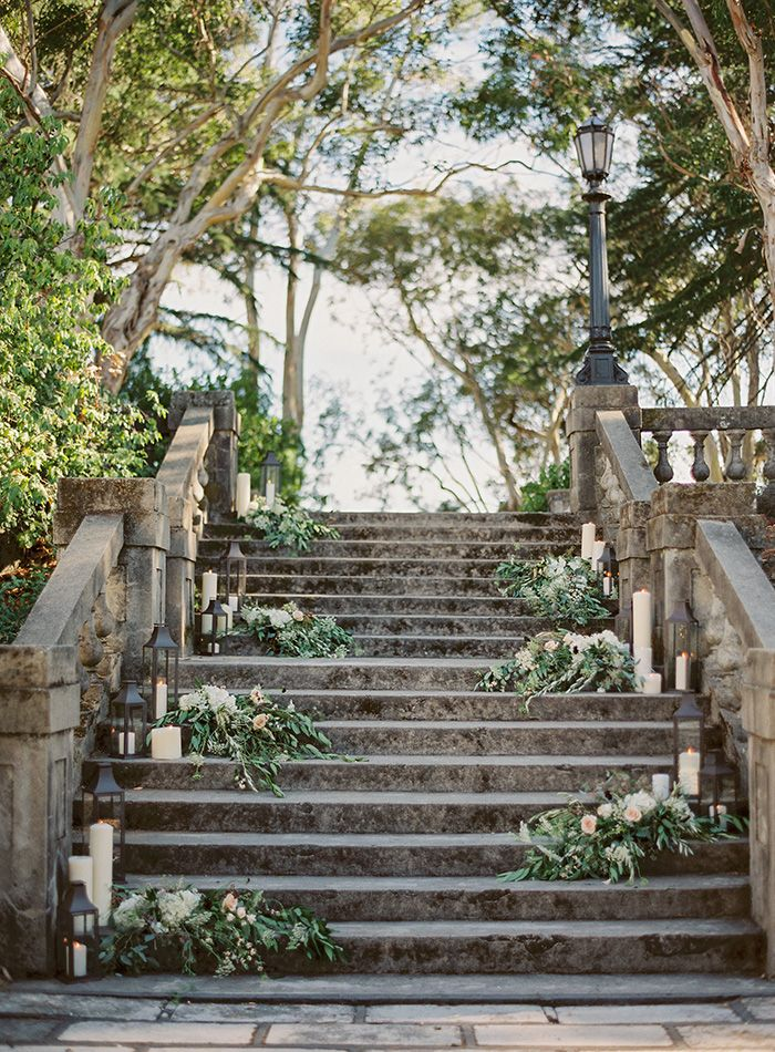 Turn any stairway into a romantic vision by adding lanterns and flowers.