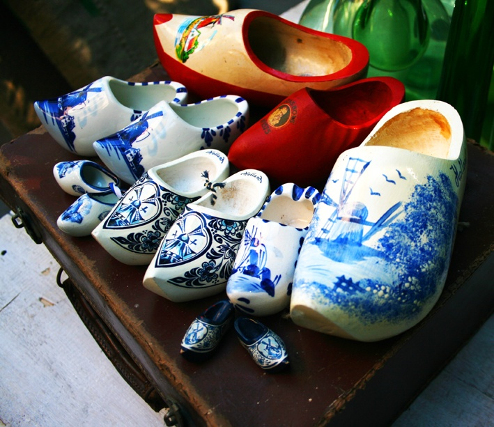 Collection of a dozen Dutch made and hand-painted clogs.