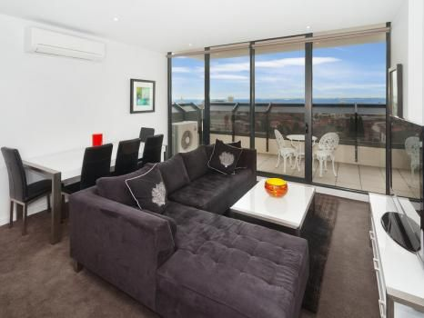 703/181 St Kilda Rd, St Kilda, Melbourne - Stunning and sweeping bay views from a large private balcony is the extra that will make your stay in this stylish St Kilda apartment an unforgettable experience. Situated a short walk from the cosmopolitan Acland St cafe precinct, this is apartment living at its best and is on offer for short stays, family or executive rentals.  This apartment comes with the maximum possible pay TV (Foxtel) package, ie, you have access to all possible channels.