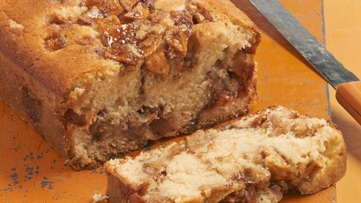Apples and cinnamon are layered into cake batter and baked into a delightfully sweet loaf cake that is a nice dessert accompanied by a scoop of vanilla ice cream.