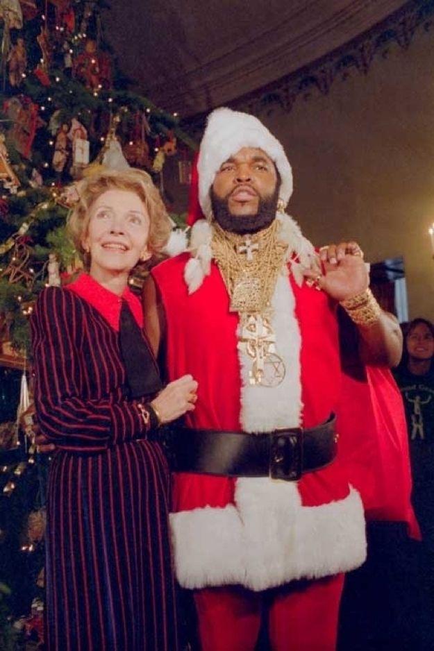 Nancy Reagan with Mr. T in a Santa suit.