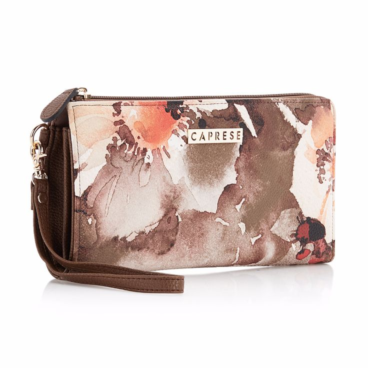 Caprese Florence Clutch. Stylish & Classy with floral design all over. Ideal for daily use. Buy now;http://acebazaar.in/product/caprese-florence-clutch-medium-orange/