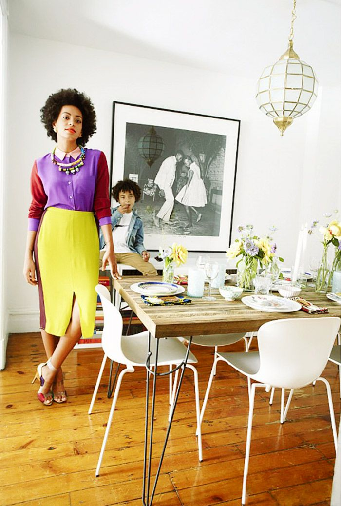 Solange Knowles in her modern-rustic dining room with son