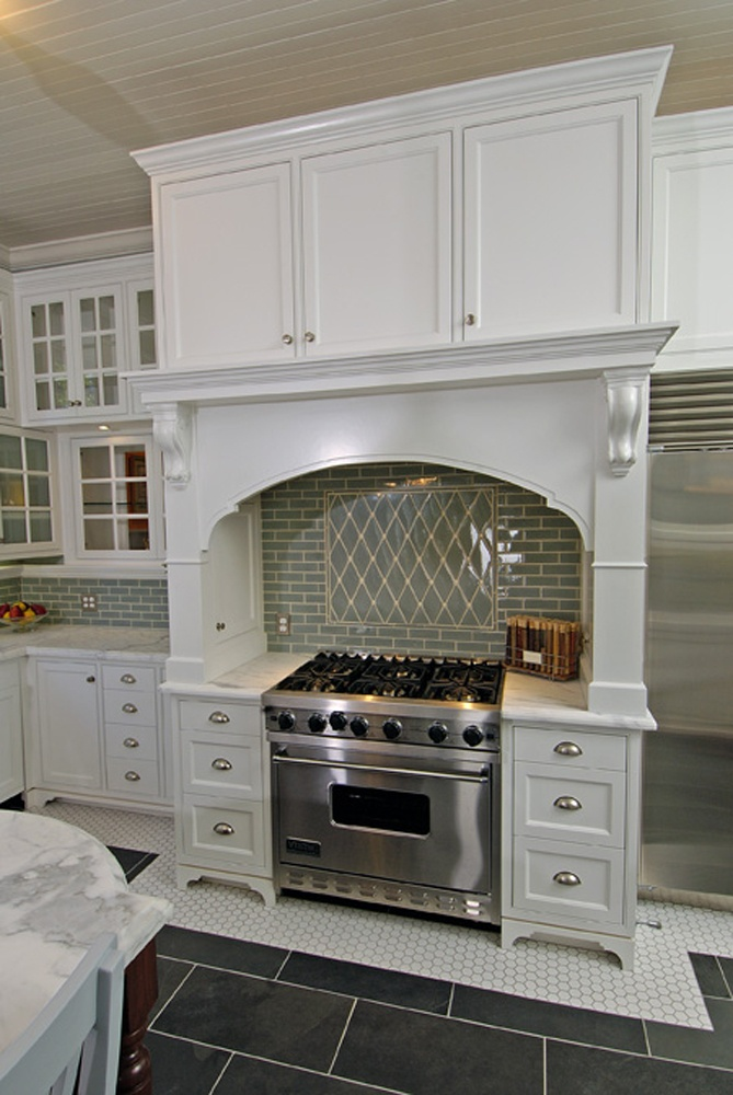 Kitchen with white cabinets and aqua subway harlequin for Artistic kitchen cabinets