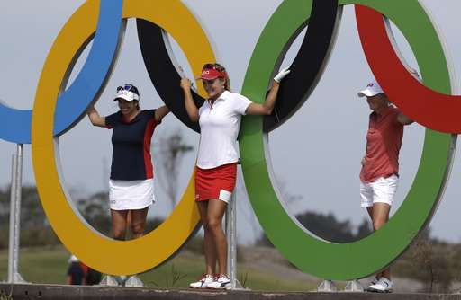 From left, United States golfers Gerina Piller, Lexi Thompson, and Stacy Lewis pose for a photo with the Olympic Rings during a practice round for the women's golf event at the 2016 Summer Olympics in Rio de Janeiro, Brazil, Tuesday, Aug. 16, 2016.
