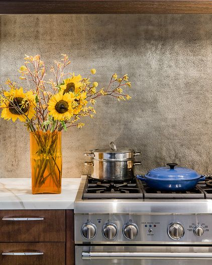 Backsplashes  Hammered sheet metal makes a great kitchen backsplash. A unified surface, void of the material changes and joints found in til...