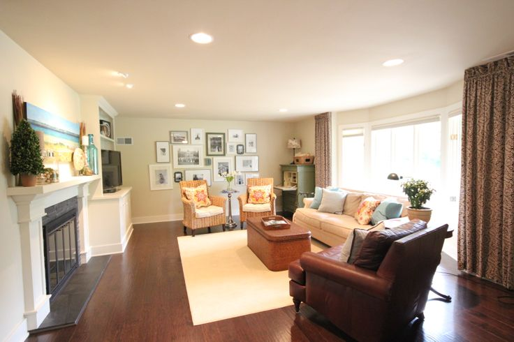 """Living room transitional decor ideas - Bay window drapery panels / window treatment - we used """"dummy"""" or stationary drapery panels and honeycomb top-down, bottom-up style blinds. Living room has Pier One banana chairs, PB leather chair coffee table/trunk, Vanguard green secretary, custom pillows Custom built fireplace tv cabinet"""