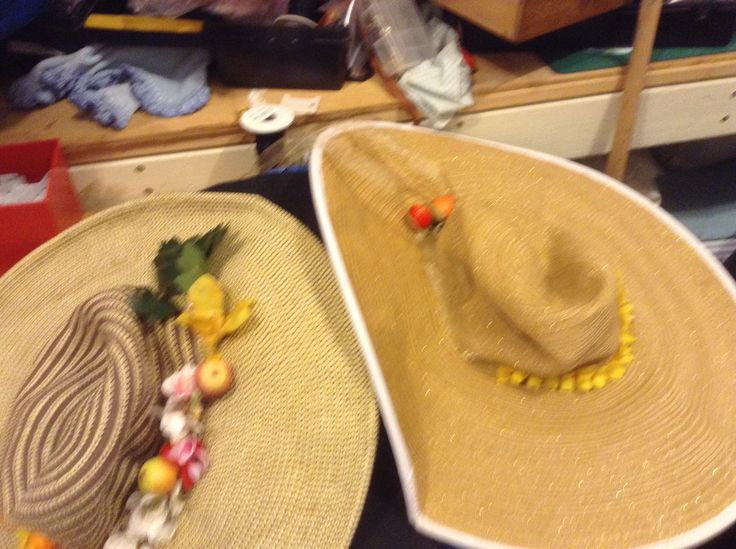 iame show, and thought I could do as good, so got some artificial flowers at Reverse Garbage (an industrial disgards warehouse in Marrickville, Sydney) and some raffia and hessian and twined it. Easy, As an Australian and a redhead, I have a lot of hats.