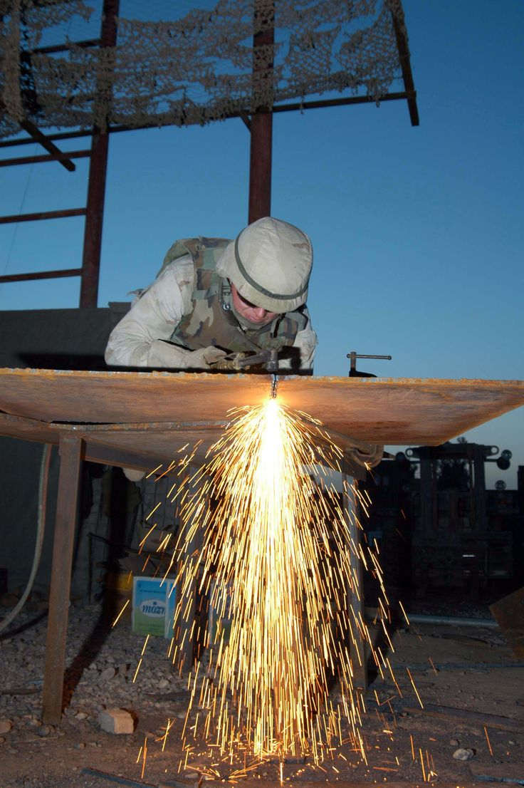 US_Navy_041113-N-5386H-050_Steelworker_1st_Class_Joseph_Perrott,_assigned_to_Naval_Mobile_Construction_Battalion_Two_Three_(NMCB_23),_cuts_steel_plating_used_to_enhance_tactical_vehicle_armor.jpg (2000×3008)