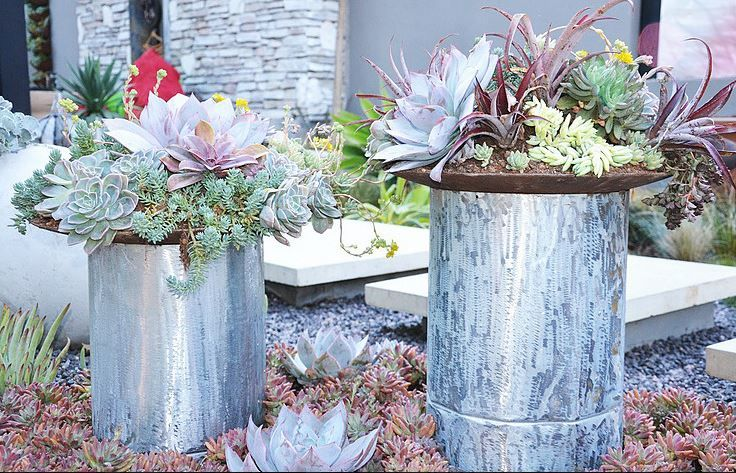 recycled Galvanized steel sheeting, rolled to create pillars, with rusted steel bowls on top