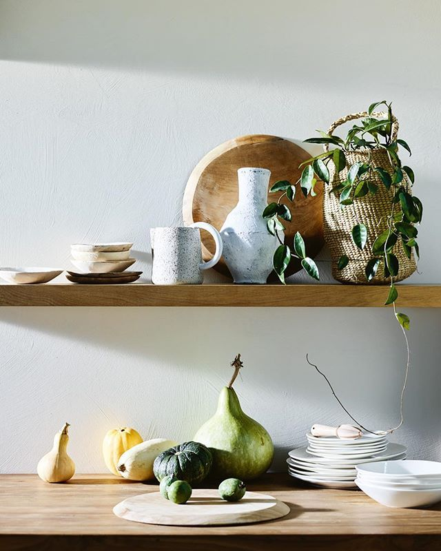 Bring light and joy to your kitchen with homewares from our September issue. Seen here: Ethnicraft floating wall shelf from @curious_grace. On shelf from left: Mr Right saucers from @pan_after. @cclaudd Circle jug from @monkhousedesign. Round teak plate from @weylandtshome. Small urn from @storie_montreux. Flower basket from @pan_after. Loren recycled wood bar counter from @schotshome. On counter from left: teak plate as before. Harlow citrus juicer from @provincialhomeliving. Mason side…