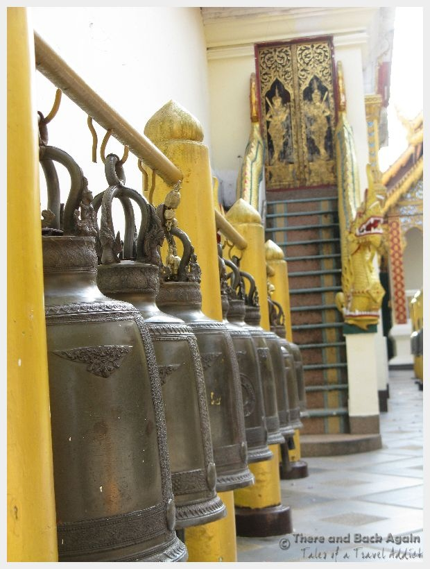 A photo taken at a temple in Thailand of some beautiful bells that are rung as part of Buddhist worship.