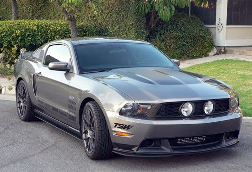 grey color with boss 302 front splitter and roush side splitters and retro style hood graphics