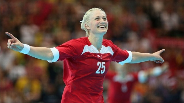 Rikke Skov of Denmark celebrates winning 21-18 in the women's Handball preliminaries Group B - Match 4 between Denmark and Sweden on Day 1 of the London 2012 Olympic Games at the Copper Box on 28 July.