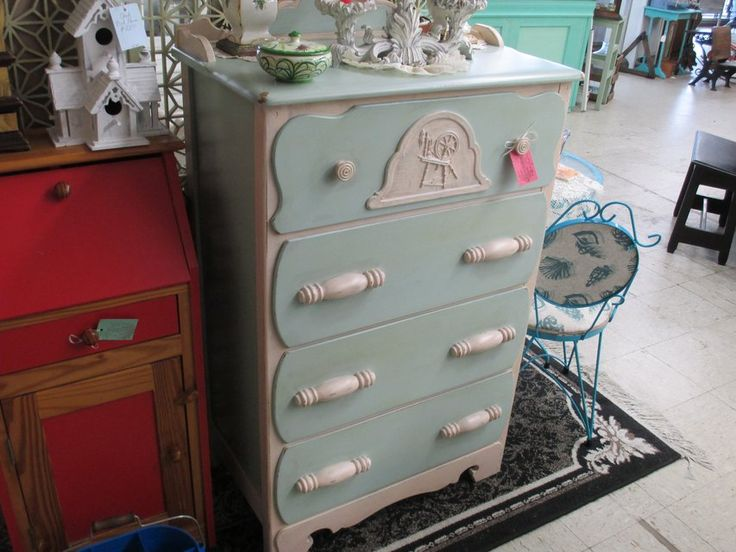 THIS BEAUTIFUL VINTAGE 4 DRAWER CHEST FRESHLY IN SEA BLUE & OFF WHITE IS LOCATED AT CLARK'S ANTIQUES ART & COLLECTIBLES LOCATED AT 237 W. MAIN ST. RT.70 HAVELOCK N.C. PLEASE STOP BY SAY HI TO TAYLORE AND SEE MORE PAINTED FURNITURE  UNPAINTED FURNITURE  LIGHTING WICKER JEWELRY GIFTS ANTIQUES COLLECTIBLES AND MANY MORE TREASURES FOR INFO. Contact Me AT 252 665 0142 OR TAYLORE AT 252 447 8102E
