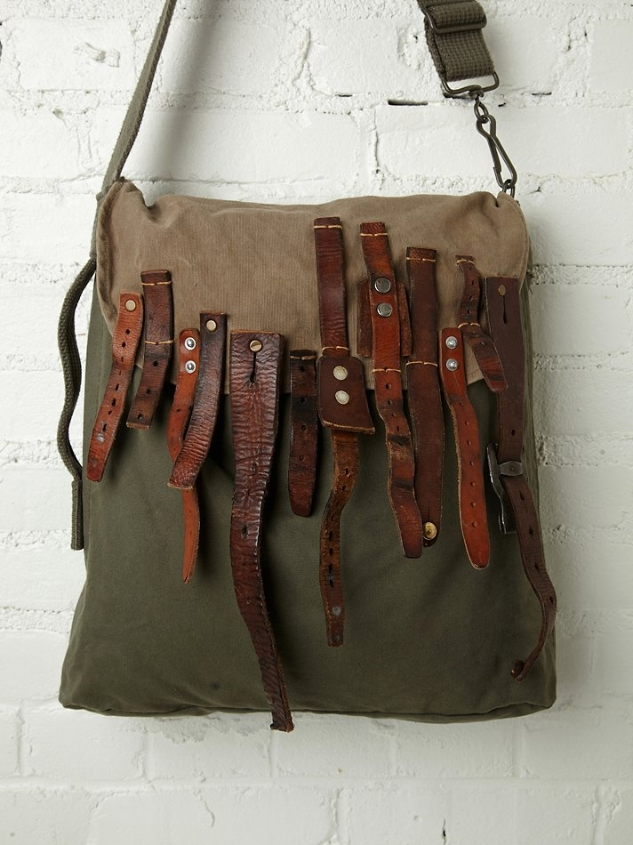 VERY COOL distressed canvas bag.....multi-buckle straps on the front flap<3<3.......this is BLACK HAWK HOBO.......by TK Garment Supply.....at Free People....