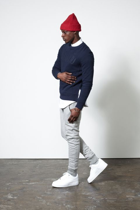 To create an outfit for lunch with friends at the weekend consider pairing a navy print crew-neck pullover with grey sweatpants. A pair of white low top sneakers will seamlessly integrate within a variety of outfits.  Shop this look for $84:  http://lookastic.com/men/looks/beanie-longsleeve-shirt-crew-neck-sweater-sweatpants-low-top-sneakers/5158  — Red Beanie  — White Longsleeve Shirt  — Navy Print Crew-neck Sweater  — Grey Sweatpants  — White Low Top Sneakers