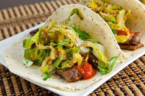 Ingredients:  12 small tortillas  1 1/2 pounds kalbi (Korean barbecue short ribs) (cut into small pieces)  1 cup Korean style salsa roja  1 cup onion and cilantro relish  2 cups shredded lettuce in a Korean sesame vinaigrette  6 tablespoons sesame seeds (toasted and crushed)    Directions:  1. Assemble tacos.