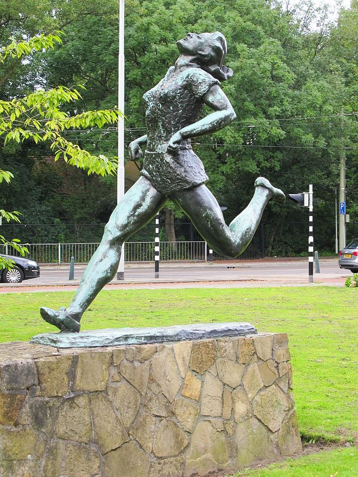 Statue of Fanny Blankers-Koen (1918 - 2004) on the ´Van Aerssenlaan´ in Rotterdam. She was a Dutch athlete. In 1948 she won at the Olympic Games in London four gold medals.