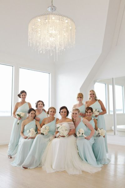 Ice blue bridesmaids dresses: http://www.stylemepretty.com/rhode-island-weddings/newport-ri/2014/12/22/seaglass-inspired-wedding-at-belle-mer-island-house/ | Photography: Sweet Monday - http://www.sweetmondayphotography.com/