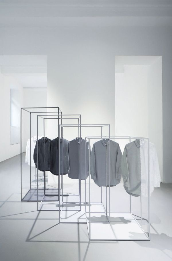 """THE SMARTLY ORDERED SHIRTS ARE CRISP, CLASSIC WHITE UNTIL THEY FALL INSIDE THE STEEL CUBE FRAMES, AT WHICH POINT THEY TAKE ON COLOUR AS THOUGH THE SPACE ITSELF HAS DYED THEM."" Oki Sato, nendo"