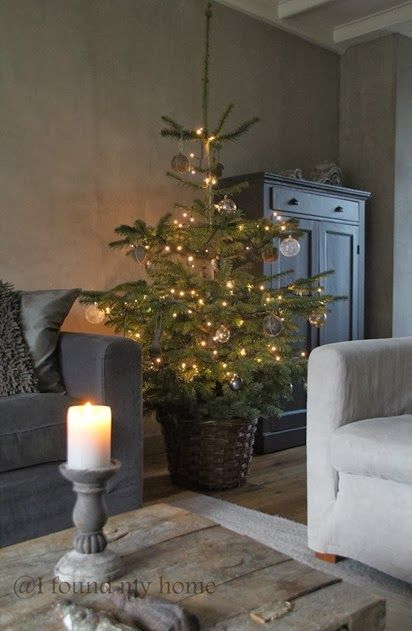 Love this rustic living room including that cute little Christmas tree!