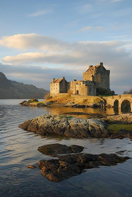 """Winter Sunlight on Eilean Donan Castle, Scottish Highlands.   Beautiful castle, both inside and out. Used for several scenes in the film """"Braveheart"""", as well as in a number of other movies."""