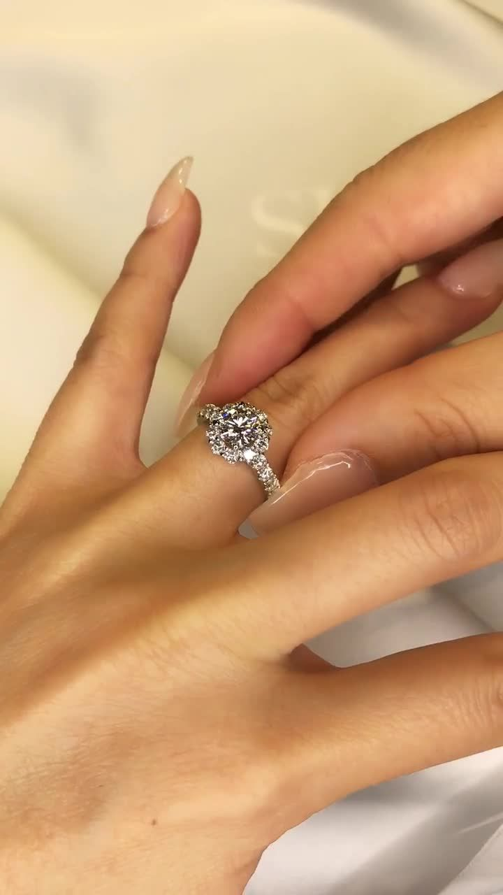 Floral halo style engagement ring with pavé set band