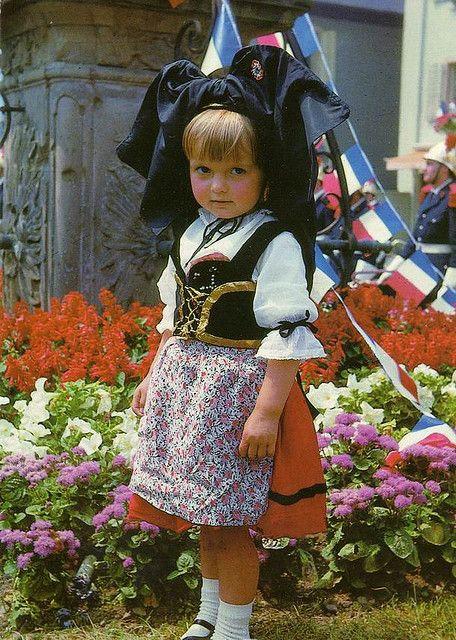 Little Parisian in traditional Alsace festive dress, France