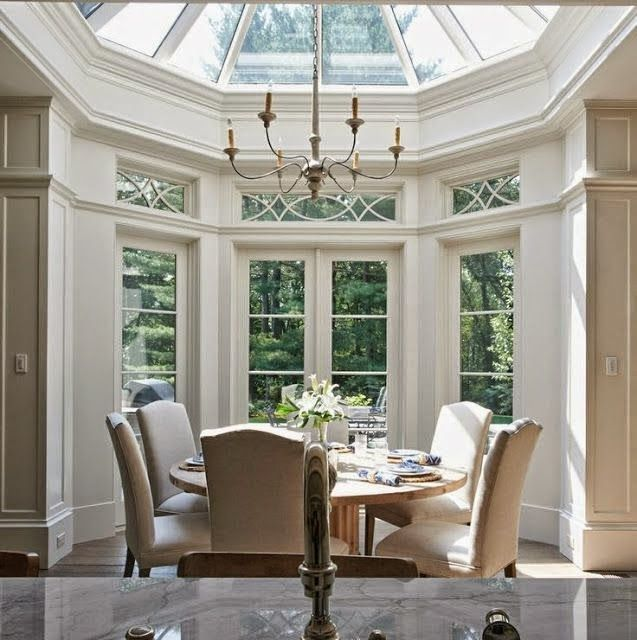 Beautiful Traditional Dining Room Design With Two Story Windows Round Table  Parsons Chairs