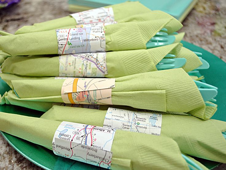 For a travel-themed party or baby shower: maps cut out for napkin rings. Love it!