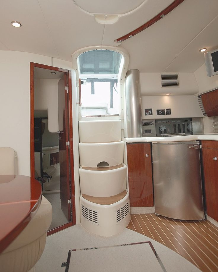 Toilet in brown colors the interior is small and cozy boat for Interior boat designs