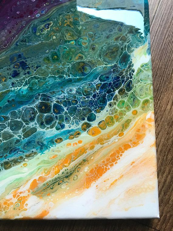 This year, I discovered abstract painting using fluid acrylics. I love the organic feel of this medium and the way it makes images that looks like things in nature. This one has a floral look. This is an original, 20x10 abstract painting in acrylic on canvas. The edges are finished to
