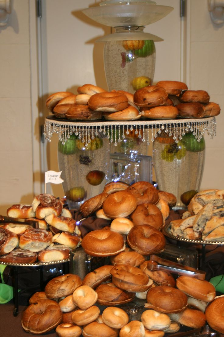 Bagel Station! This is such a fun way for your guests to be able to choose different types of  bagels and top with all their favorite toppings.  www.twofatmencatering.com