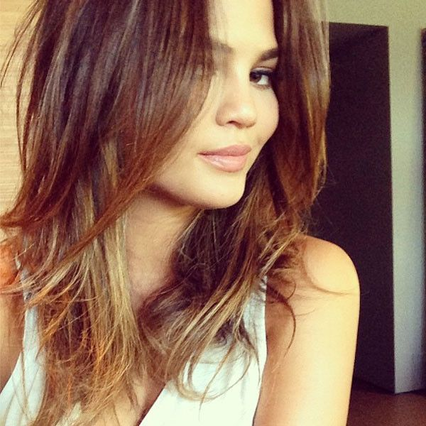 Chrissy Teigen lightens her locks for summer -- click to our site for the details!