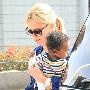 Charlize Theron & Jackson  The new mom gets ready to catch a plane with her little man.