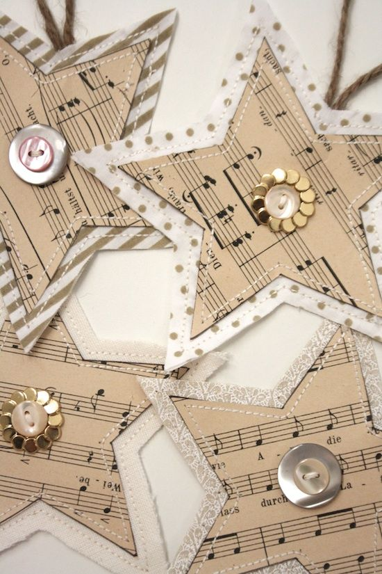 Using hand crafted decorations featuring vintage music sheets and a colour scheme of naturals, gold and and a bit of Christmas sparkle....love these!