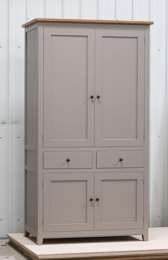 Larder cupboard handpainted in Farrow & Ball Estate Egshell - 'Charleston Gray'. Tulip wood carcass with painted birch ply panels and oak faced birch ply shelves. Dovetailed oak drawers on high quality soft close runners. Oak spice racks. High quality solid brass hinges and adjustable brass shelf supports. Solid oak cornice and walnut knobs.